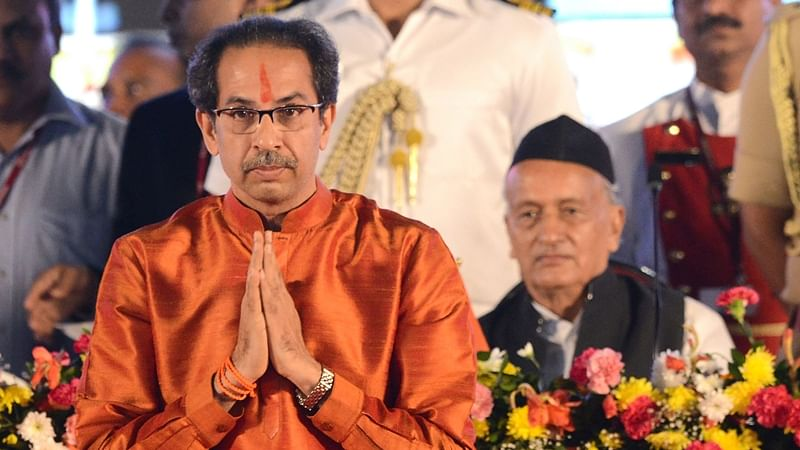 Maharashtra's Governor Bhagat Singh Koshyari (R) looks on as new chief minister Uddhav Thackeray gestures after taking his oath of office during a swearing-in ceremony in Mumbai.