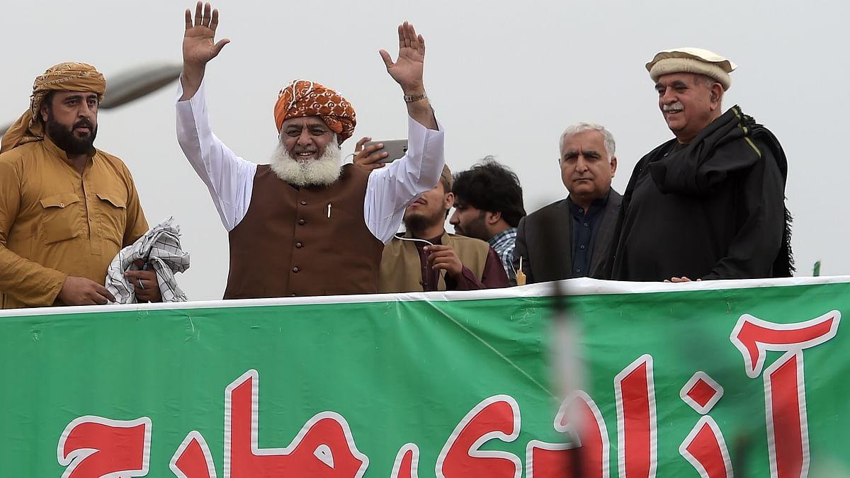 "Islamic political party Jamiat Ulema-e-Islam (JUI-F) leader Maulana Fazlur Rehman (2L) waves during anti-government ""Azadi (Freedom) March"" in Islamabad."