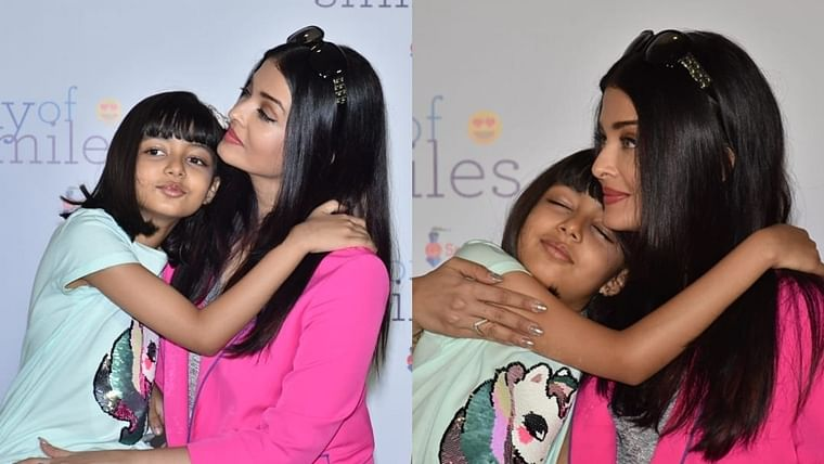 Mama's Girl! Aaradhya snuggling up to mom Aishwarya during an event is all things adorable