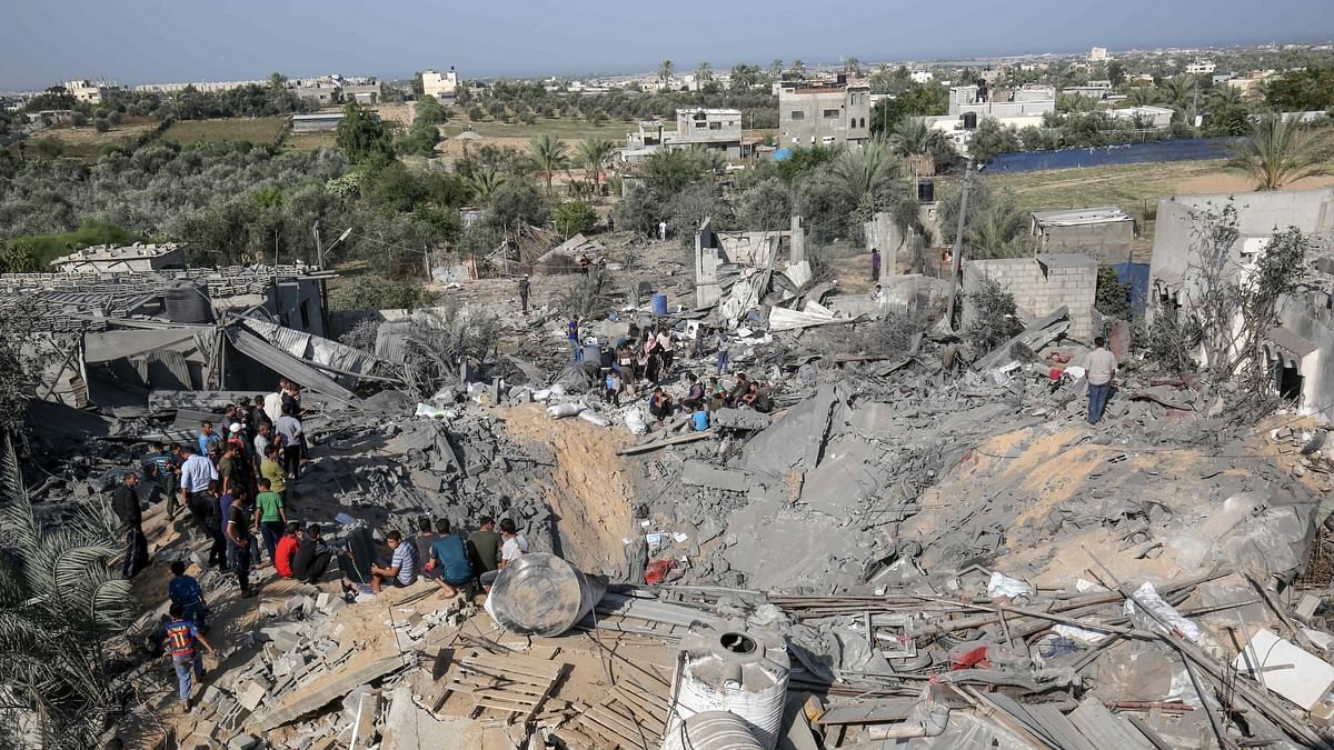 Palestinians check the destruction following an Israeli air strike on November 14, 2019 in Khan Yunis in the southern Gaza Strip.