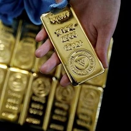Gold shines as Dow Jones continues to fly high