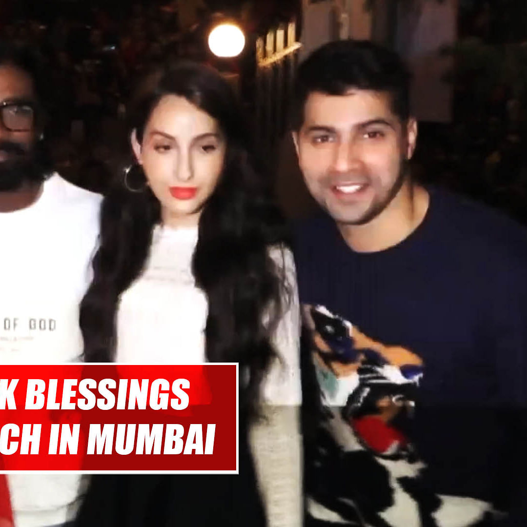 Varun Dhawan, Nora Fatehi seek blessings at Mount Mary church in Mumbai