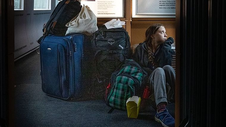 Greta Thunberg tweets photo of herself sitting on floor of crowded train, railway company responds