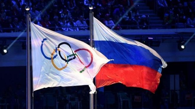 Russia's national flag along with the Olympic flag (left)