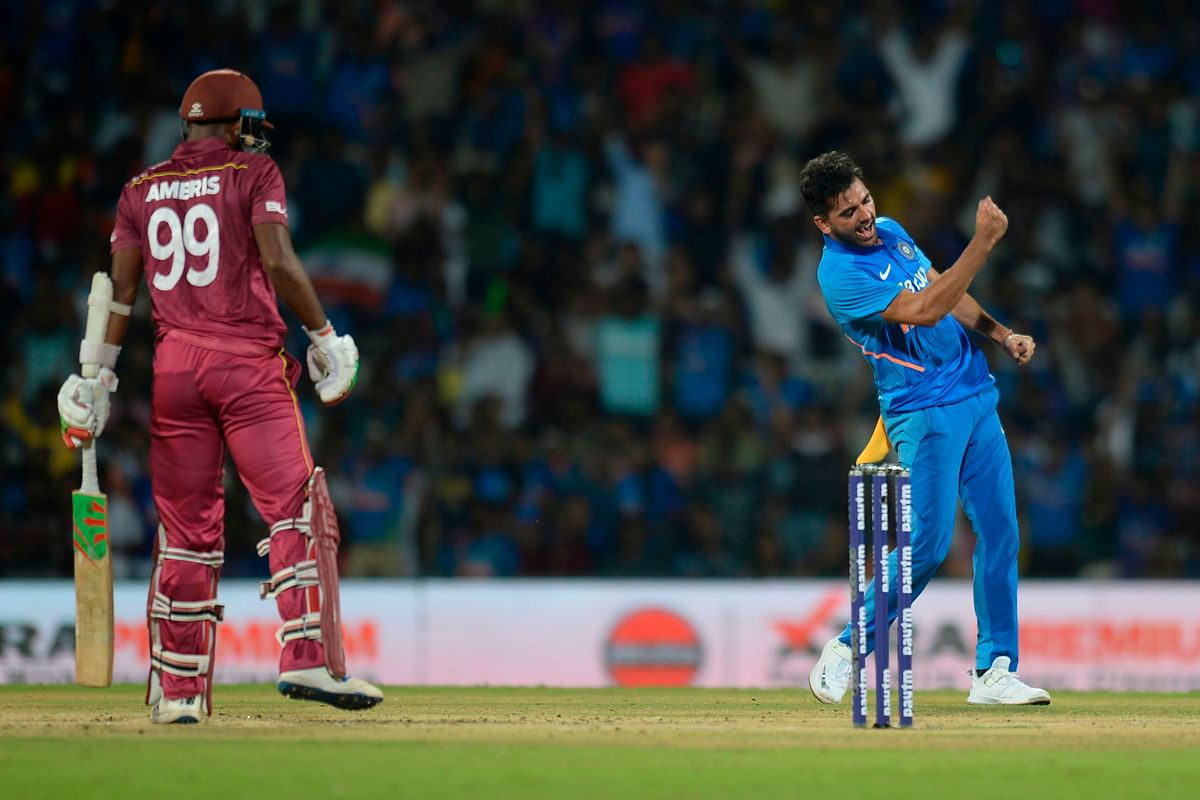 India's Deepak Chahar (R) celebrates the wicket of West Indies' Sunil Ambris (L) during the first one day international cricket match of a three-match series between India and West Indies, at the M.A. Chidambaram Cricket Stadium in Chennai on December 15, 2019.