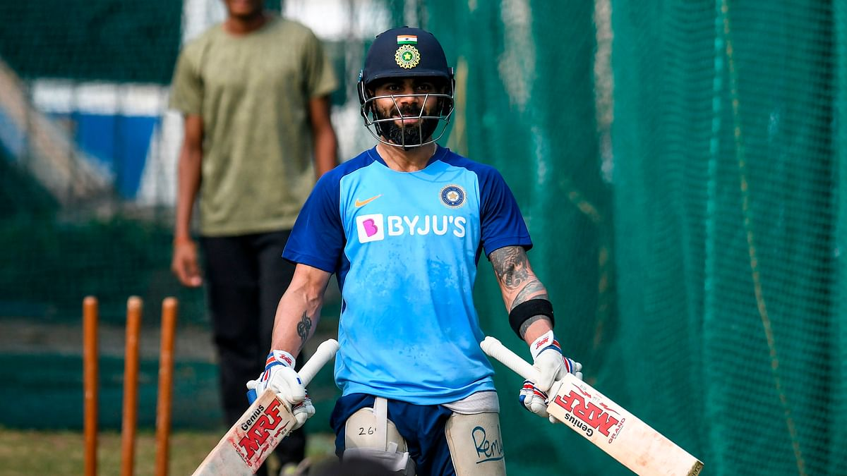 India's captain Virat Kohli gestures as he holds two bats during a training session ahead of the first T20 international cricket match of a three-match series between India and West Indies at the Rajiv Gandhi International Cricket Stadium in Hyderabad on December 4, 2019.