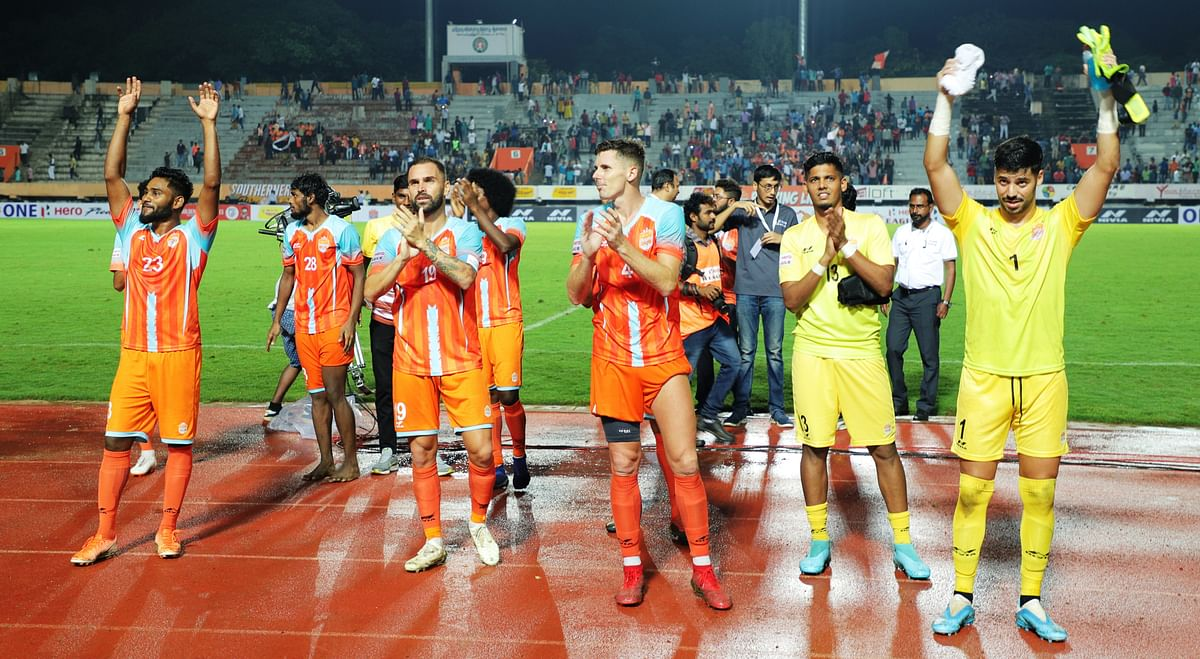 Chennai City FC team greeting their fans after starting their season with a 1-0 win against TRAU FC at the Nehru Stadium, Coimbatore on Sunday.