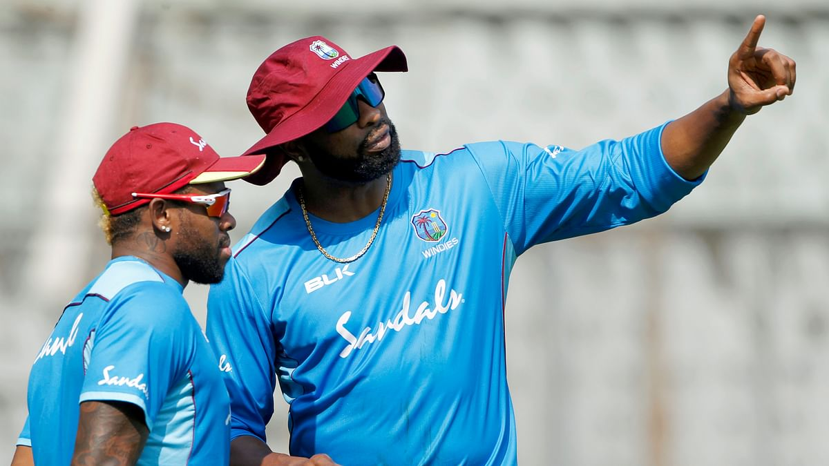 West Indies skipper Kieron Pollard with Fabian Allen (L) during a practice session ahead of the 3rd T20  match against India at Wankhede Stadium in Mumbai.