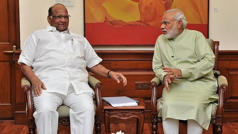 NCP chief Sharad Pawar's (L) with (R) Prime Minister Narendra Modi