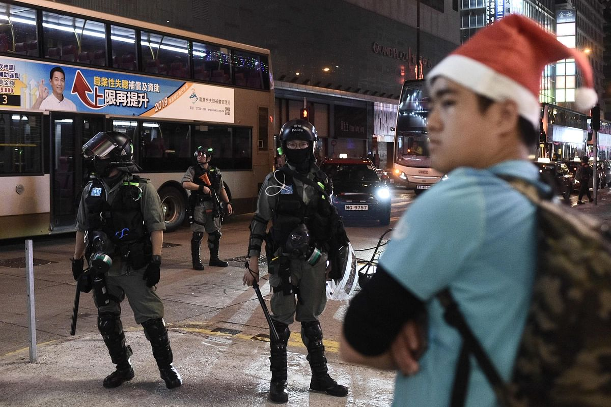 Hong Kong: Pro-democracy activists celebrate Christmas protesting and being pepper-sprayed by police