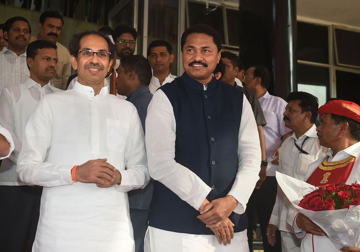 Maharashtra Chief Minister Uddhav Thackeray and State Assembly Speaker Nana Patole wait to receive Maharashtra Governor Bhagat Singh Koshyari at Vidhan Bhavan for State Assembly session in Mumbai, Sunday, Dec. 1, 2019.