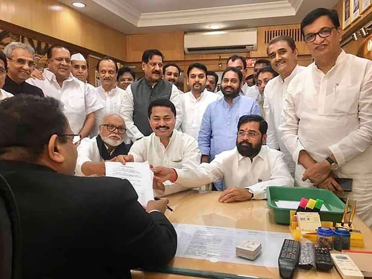 Congress MLA Nana Patole files his nomination for Maharashtra Assembly Speaker's post as senior NCP and Congress leaders look on, in Mumbai, Saturday, Nov. 30, 2019.