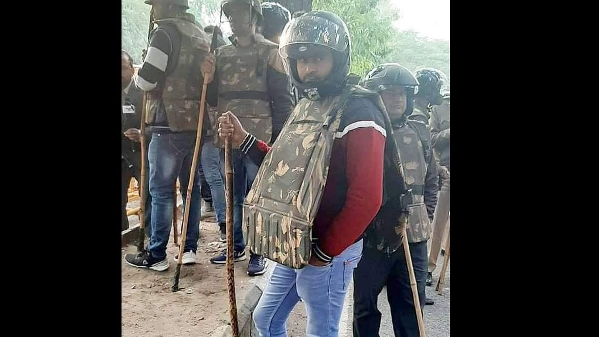 Cop or RSS volunteer - who's the guy in plain clothes seen during CAA protests in Delhi?