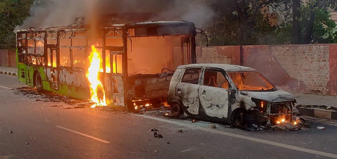Delhi: Buses set ablaze by protesters near Bharat Nagar over Citizenship Amendment Act
