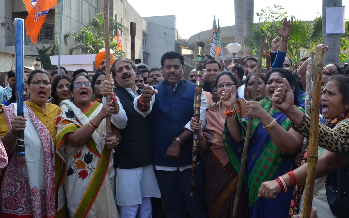 BJP MLA Rameshwar Sharma picks up stick to 'protect' party office from Cong MLA Arif Masood