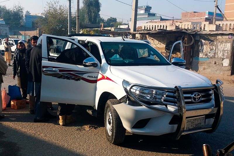 Afghan security force personnel inspect a vehicle, which was carrying Japanese doctor Tetsu Nakamura, following an attack in Jalalabad on December 4, 2019. - Five Afghans were killed and a Japanese aid worker wounded on December 4 in an attack in Jalalabad city in the eastern province of Nangarhar, officials said.