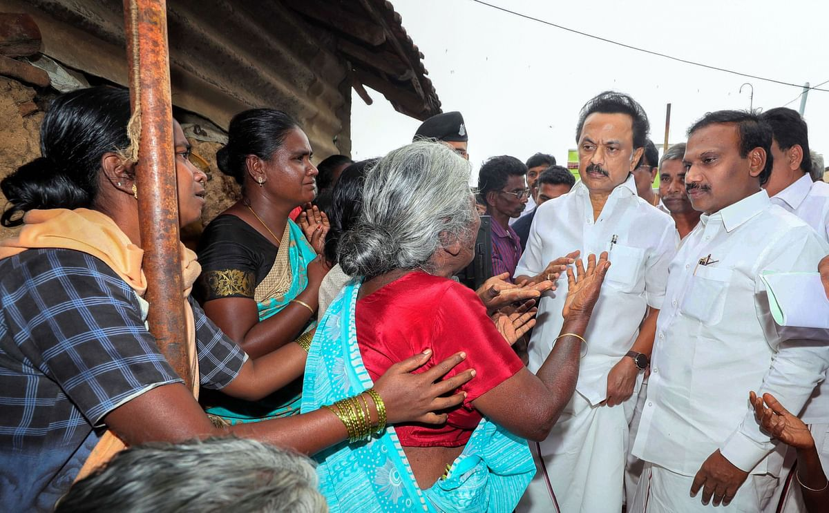 DMK Leader MK Stalin with Nilgiri MP A Raja consoles people at the site of the wall collapse in Nadur village of Mettupalayam taluk, near Coimbatore, Tuesday, Dec. 3, 2019.