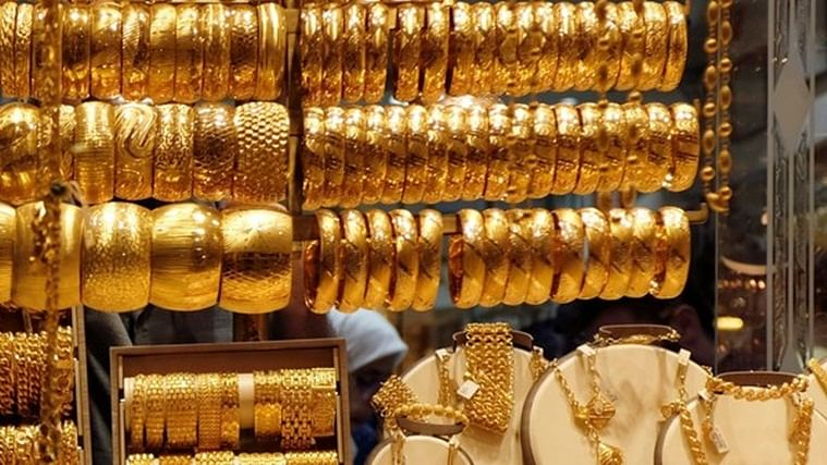 Gold prices steady amid trade tensions and rise in rupee