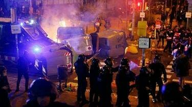 Demonstrators rocked a police van and took down street signs that they added to the barricade.