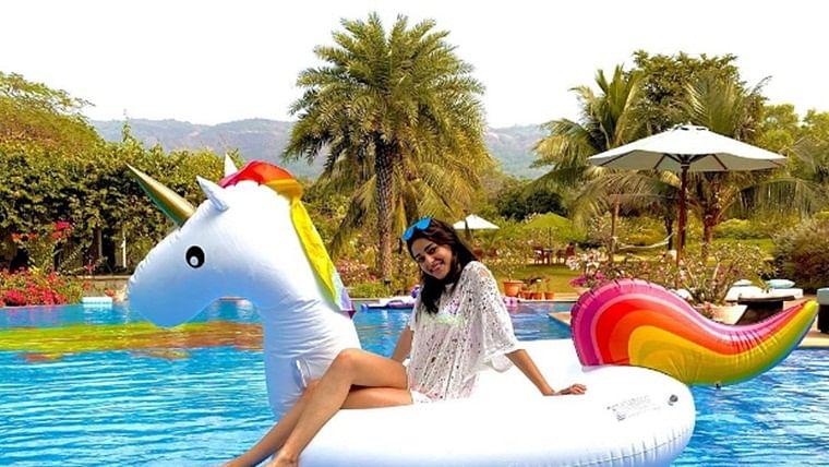 Ananya Panday enjoys some pool time wearing a white mesh dress and neon bikini