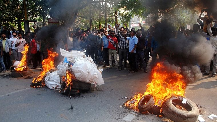 Demonstrators burn tyres and shout slogans during the strike called by All Assam Students Union (AASU) and North East Students Organization (NESO) in protest against the Citizenship Amendment Bill, in Guwahati on Tuesday