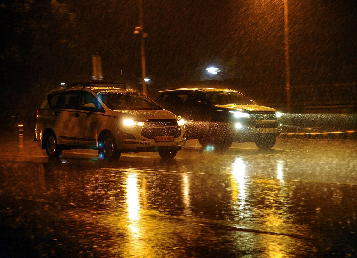 Vehicles ply during rain in New Delhi, Thursday, Dec.12, 2019.