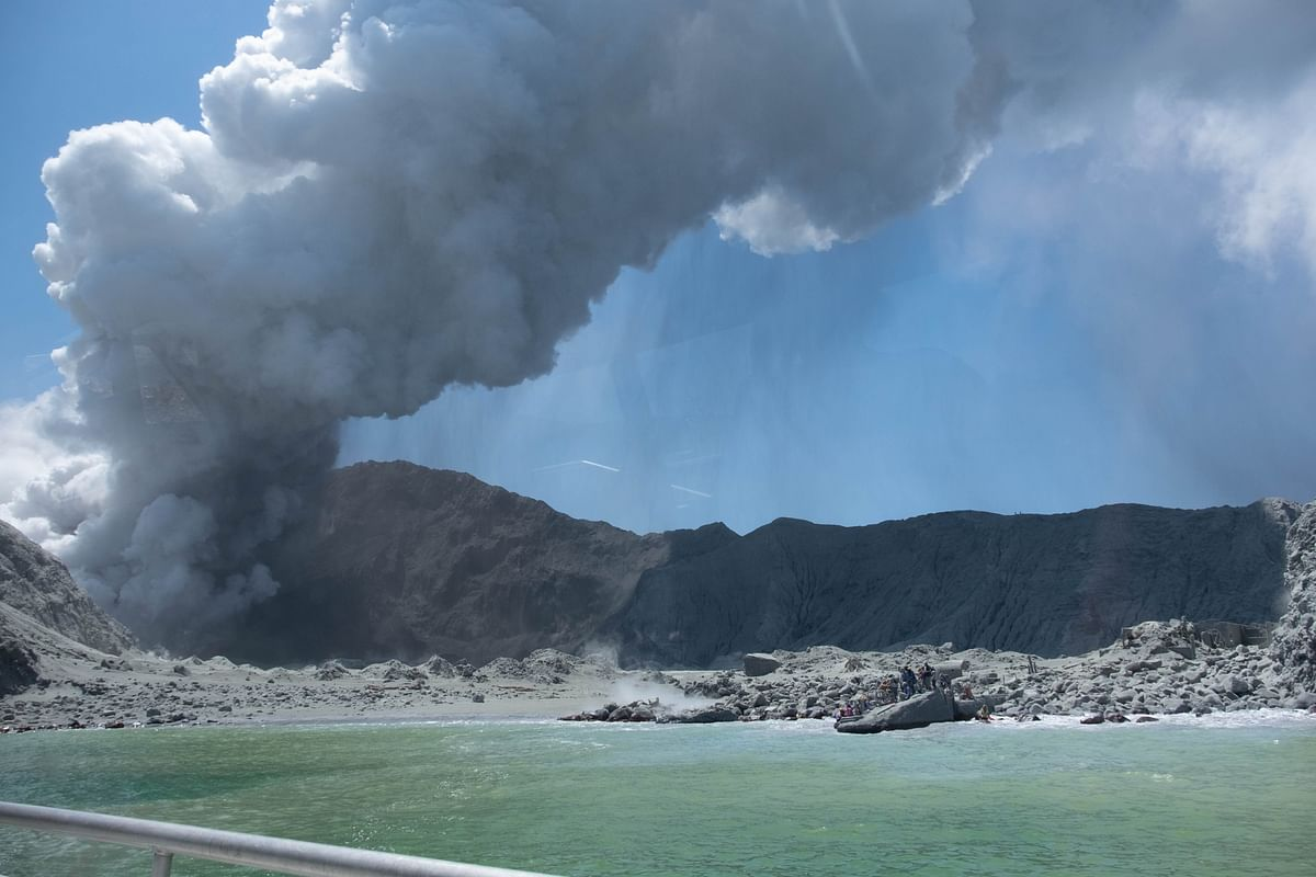 One dead, many missing after volcano erupts in New Zealand