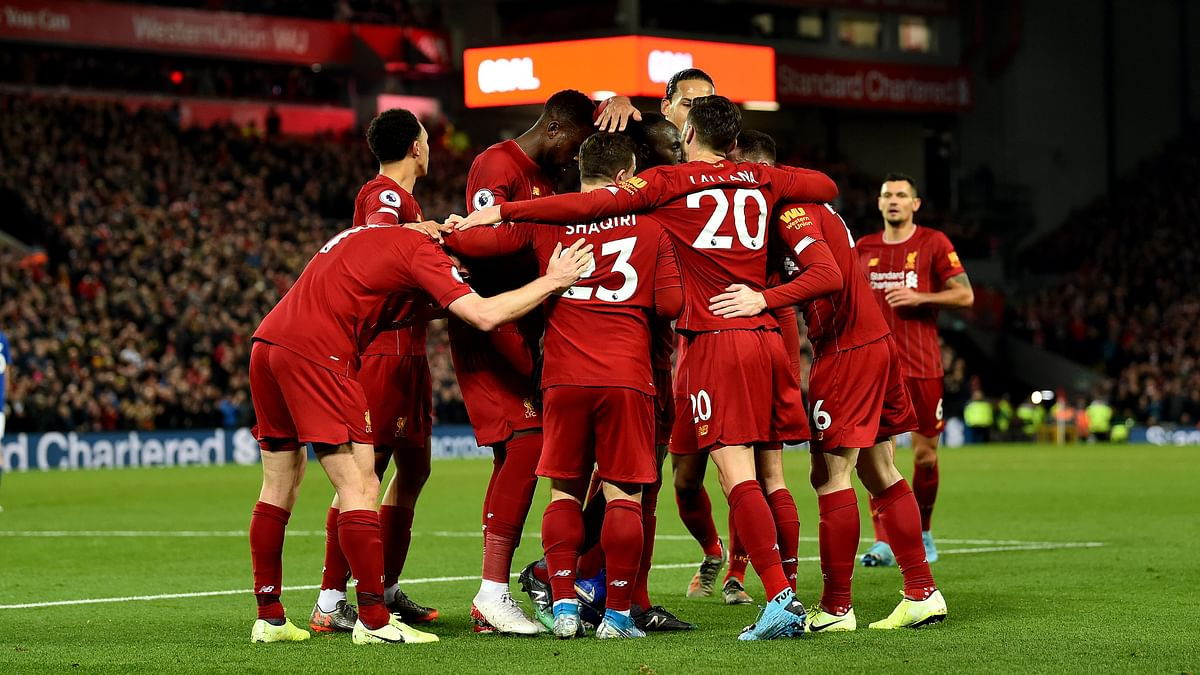 Liverpool beat Everton 5-2 in the Merseyside Derby to maintain eight points lead off Leicester City