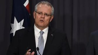 Australian PM ends holiday to face fire crisis back home