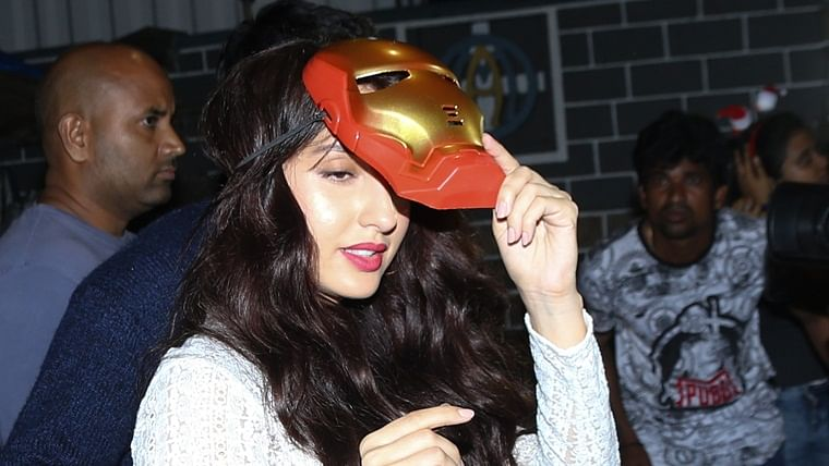 Thank god Tony Stark died before seeing this: Nora Fatehi tries to escape fans wearing 'Iron Man' mask