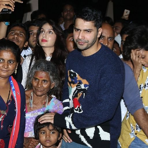 Bodyguard Fail: Varun Dhawan escapes on paparazzi's scooter after being mobbed by fans