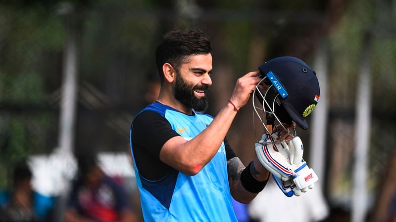 Indian cricket captain Virat Kohli prepares to wear his helmet prior to batting during a training session ahead of the first T20 international cricket match of a three-match series between India and West Indies, at the Rajiv Gandhi International Cricket Stadium in Hyderabad on December 5, 2019.