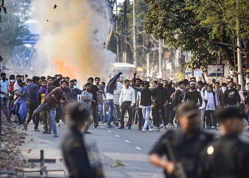 **RPT (CORRECTS TYPOS)** Guwahati: Protestors throw stones as they clash with the police during their march against the Citizenship (Amendment) Bill, 2019, in Guwahati, Wednesday, Dec. 11, 2019.