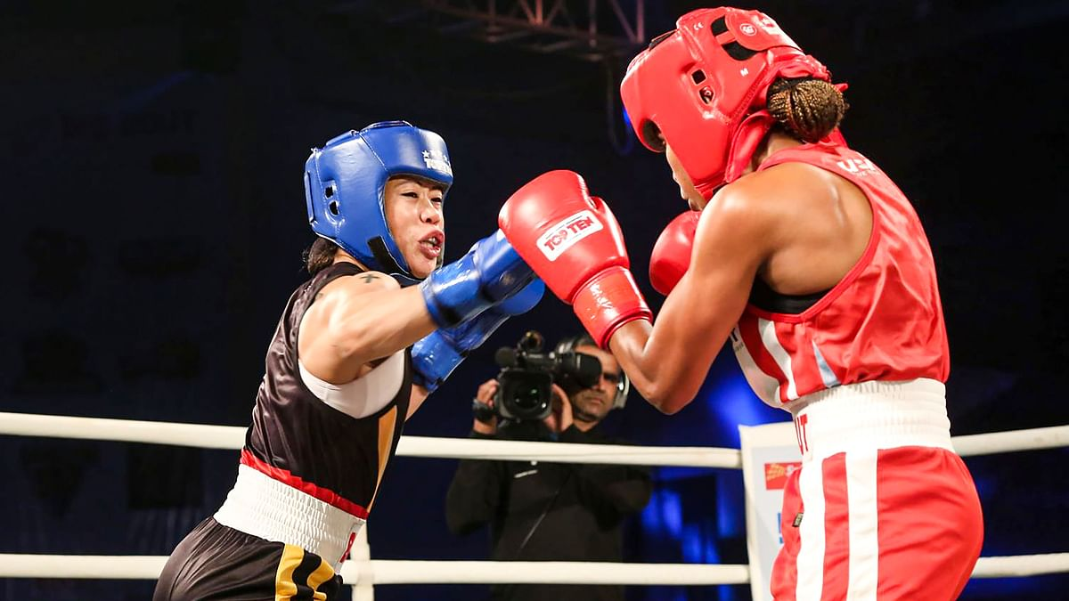 Punjab Panthers' MC Mary Kom in a bout against Bombay Bullets' Ingrit Lorena Valencia (in red) during Big Bout Indian Boxing League at the Gautam Buddha University Indoor Stadium, in Greater Noida, Thursday, Dec. 5, 2019.