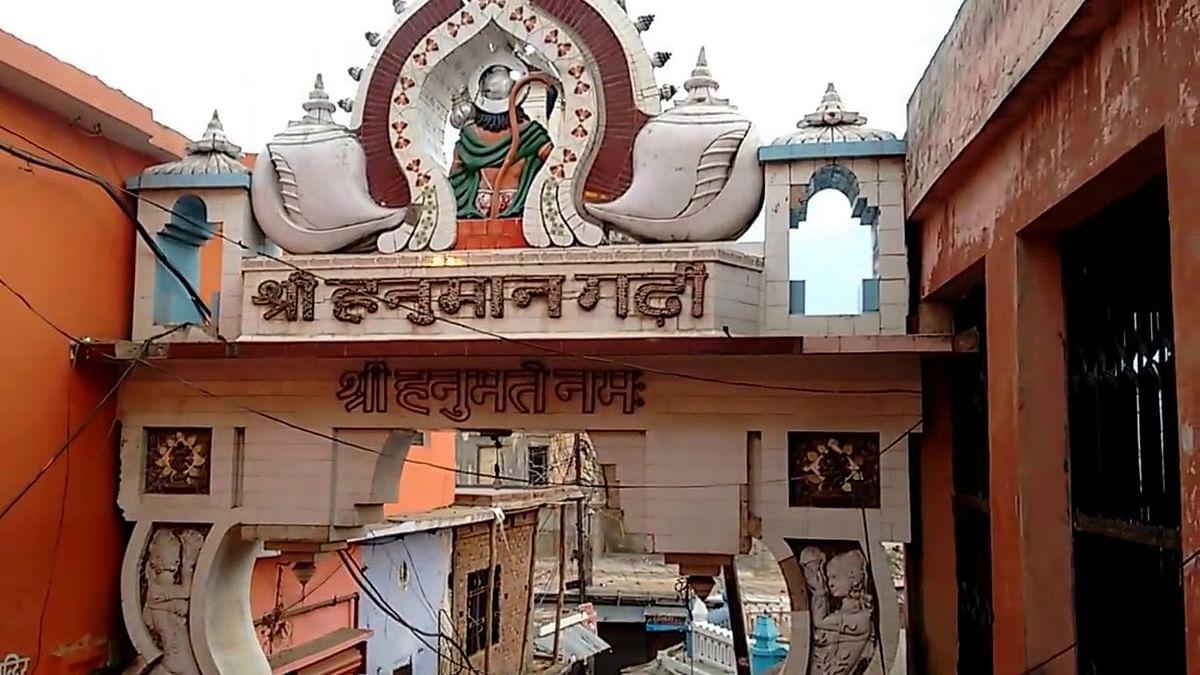 A Muslim man decorates Hindu gods in Ayodhya