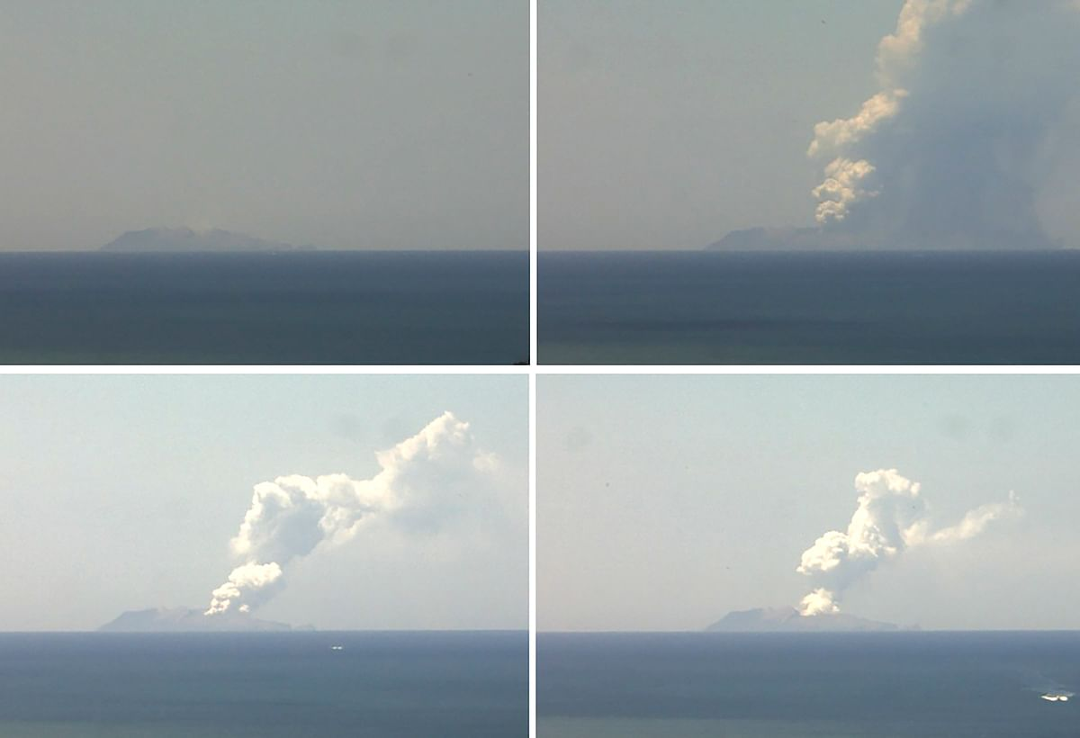 This combination of handout images from a webcam belonging to the Institute of Geological and Nuclear Sciences shows the volcano on New Zealand's White Island spewing steam and ash on December 9, 2019