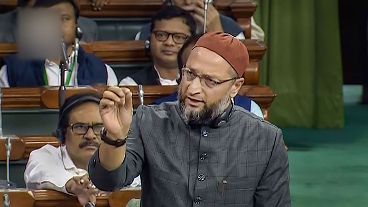 All India Majlis-e-Ittehadul Muslimeen (AIMIM) MP Asaduddin Owaisi  speaks in the Lok Sabha during the Winter Session of Parliament, in New Delhi, Monday, Dec. 9, 2019.