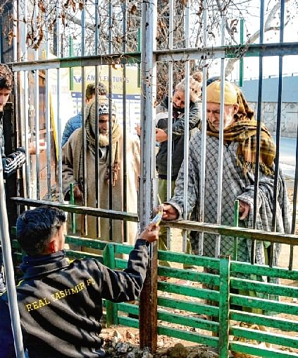 A fan buys tickets for I-league match between Real Kashmir FC and Chennai City FC in  Srinagar on Wednesday. The city also recorded coldest night of the season so far.