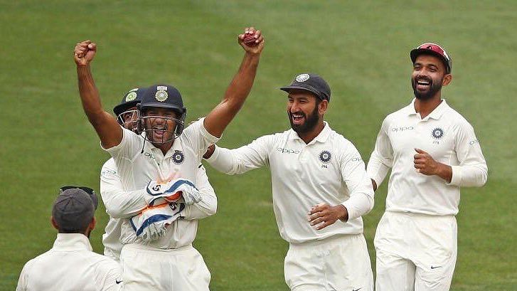 Mayank Agarwal (second from left) celebrates with teammates on his Test debut against Australia