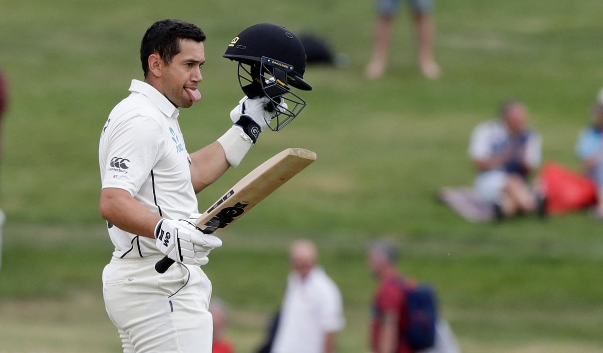 New Zealand's Ross Taylor celebrates after scoring a century during play on the final day of the second cricket test between England and New Zealand at Seddon Park in Hamilton on Tuesday.