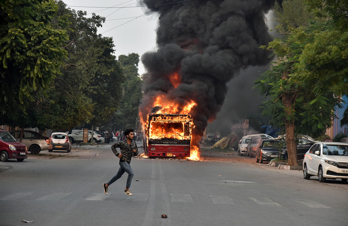 Delhi Transport Corporation buses set ablaze by protesters over the Citizenship Amendment Act near Jamia Nagar in New Delhi on Sunday