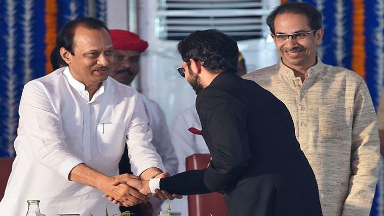 Shiv Sena leader Aaditya Thackeray greets Mahasrashtra Deputy CM Ajit Pawar as CM Udhav Thackeray looks on.