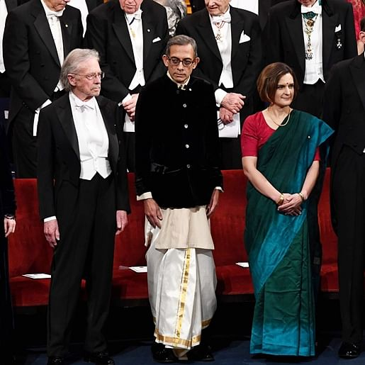 Abhijit Banerjee and Esther Duflo keep it desi in 'dhoti' and 'saree' while receiving Nobel Prize