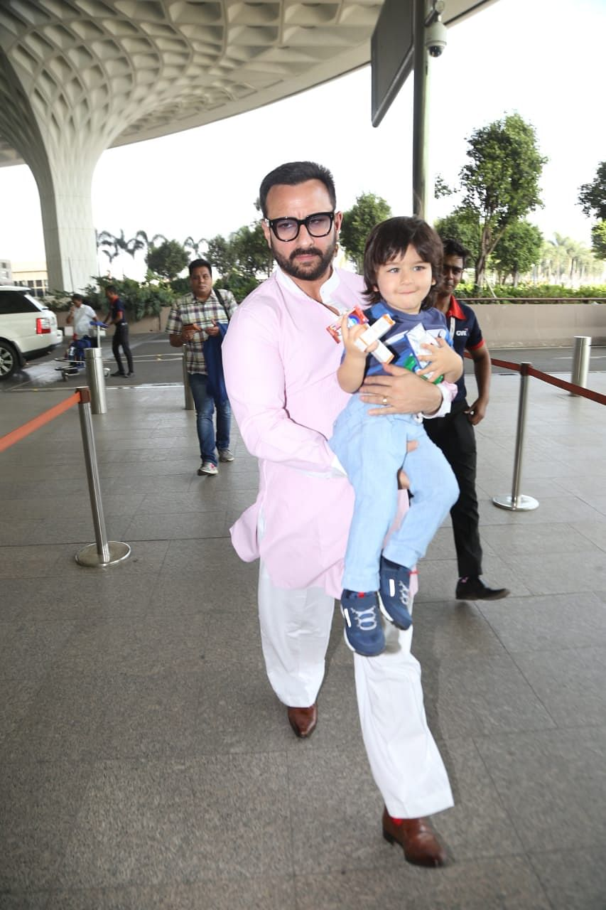 Taimur with Saif at the airport