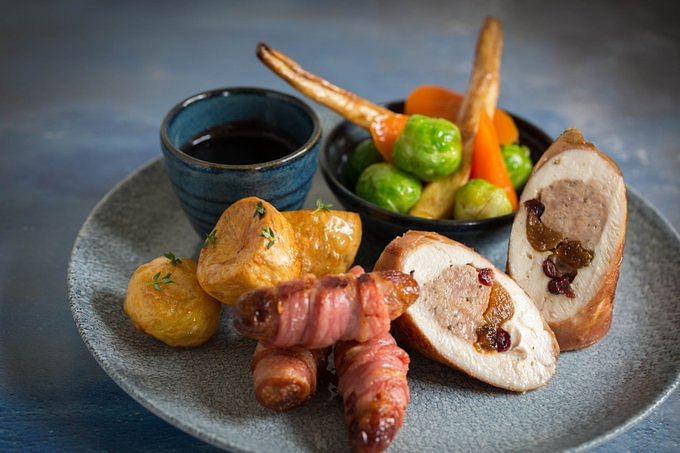 Ballantine of turkey breast, wrapped in serrano parma ham with pork & apricot stuffing.