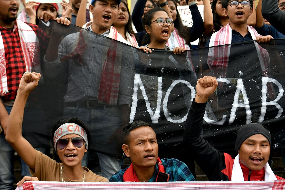 Assamese residents of Bangalore hold placards and shout slogans against the Indian government's Citizenship Amendment Bill during a protest in Bangalore on December 14, 2019.