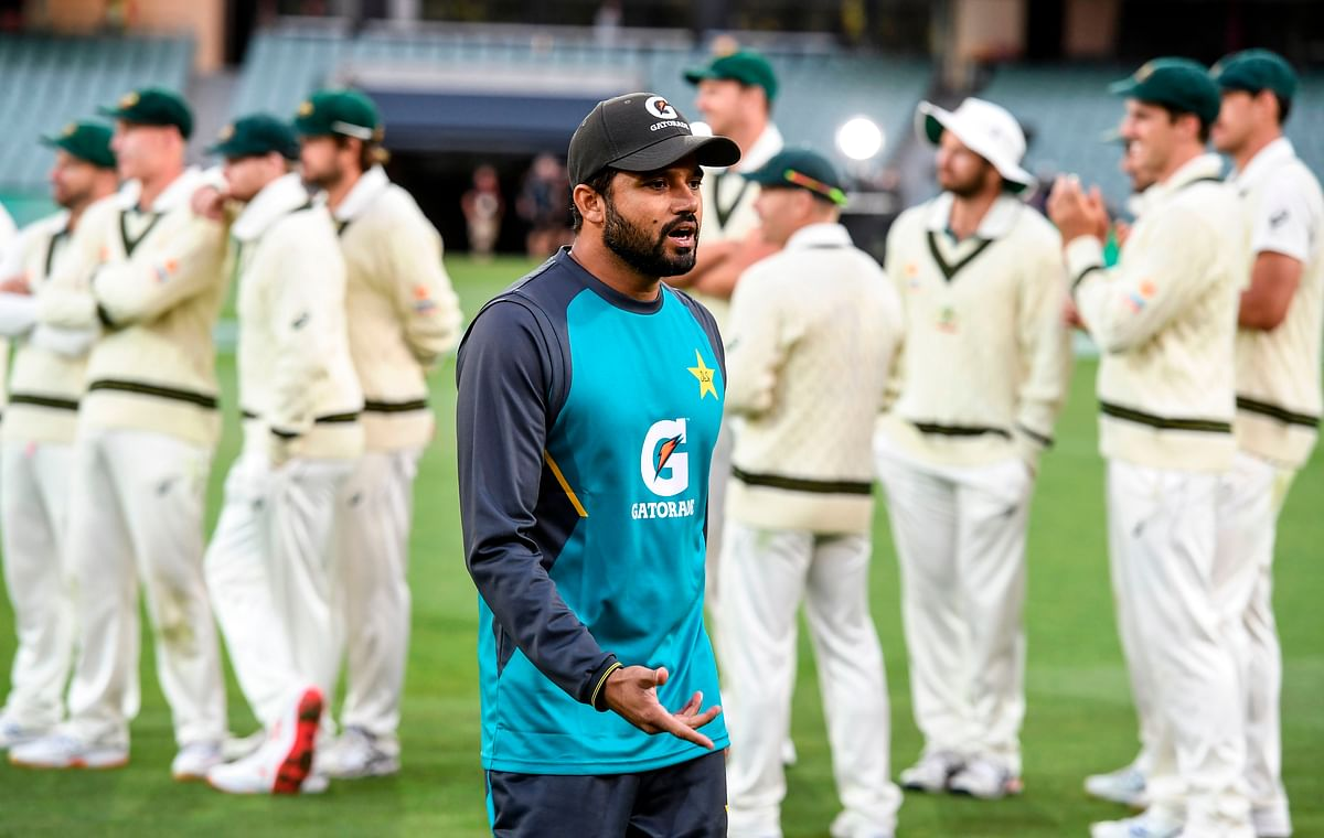 Pakistan's captain Azhar Ali (C) walks past the Australian team after Australia defeated Pakistan on the fourth day of the second cricket Test match in Adelaide.