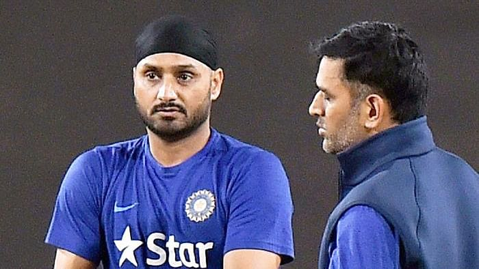 Harbhajan Singh (left) with MS Dhoni (right)