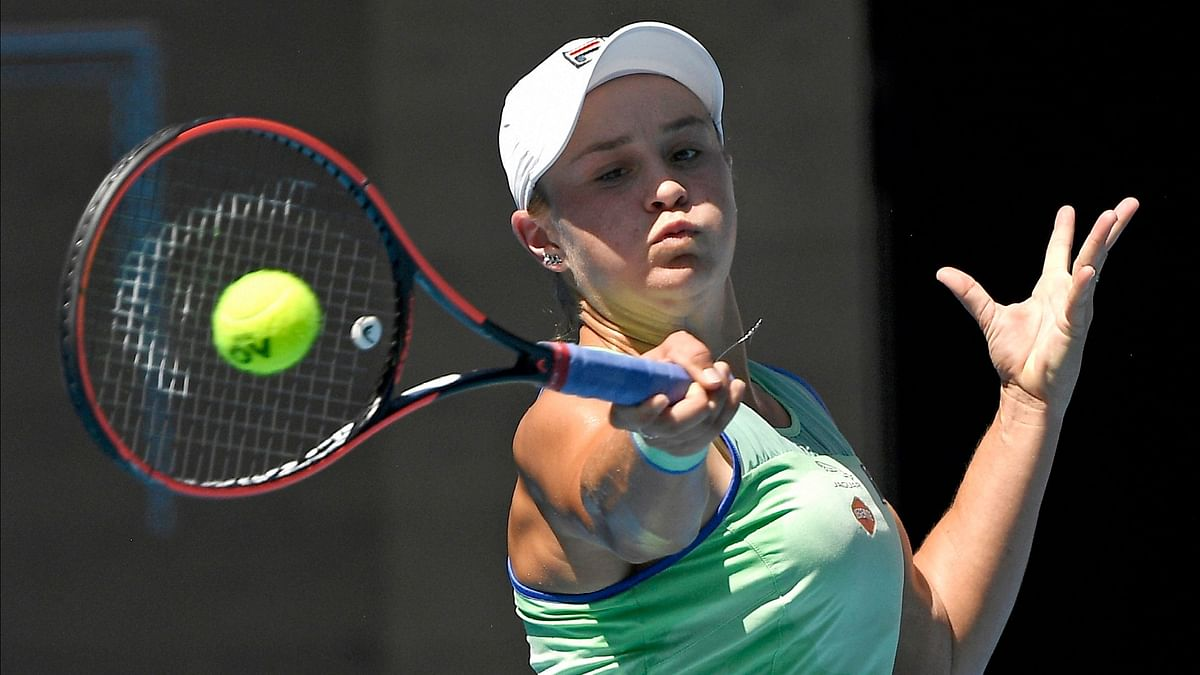 Australia's Ashleigh Barty makes a forehand return to Sofia Kenin of the U.S. during their semifinal match at the Australian Open tennis championship in Melbourne, Australia, Thursday, Jan. 30, 2020.