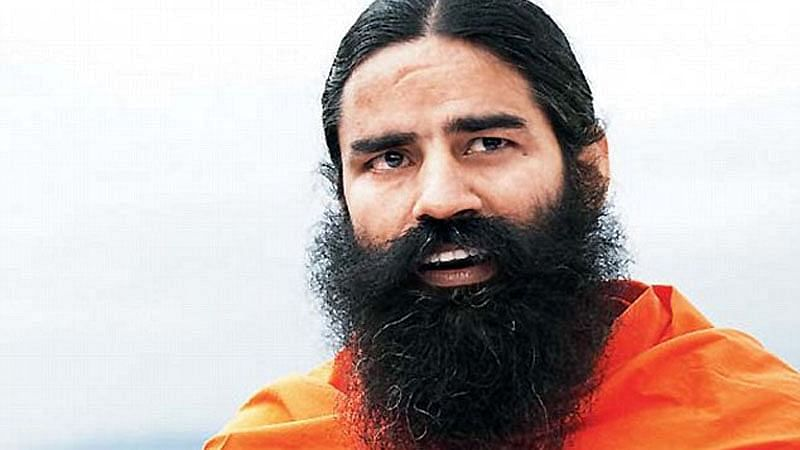 Caught on live TV: Baba Ramdev slips while cycling in the rain, video goes viral